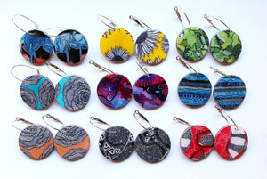 large disc earrings in the pattern galaxy