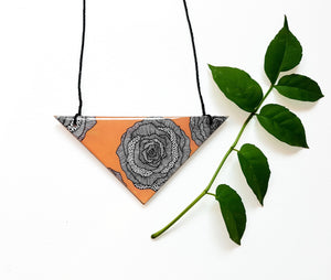 triangle pendant necklace in the pattern peach rose