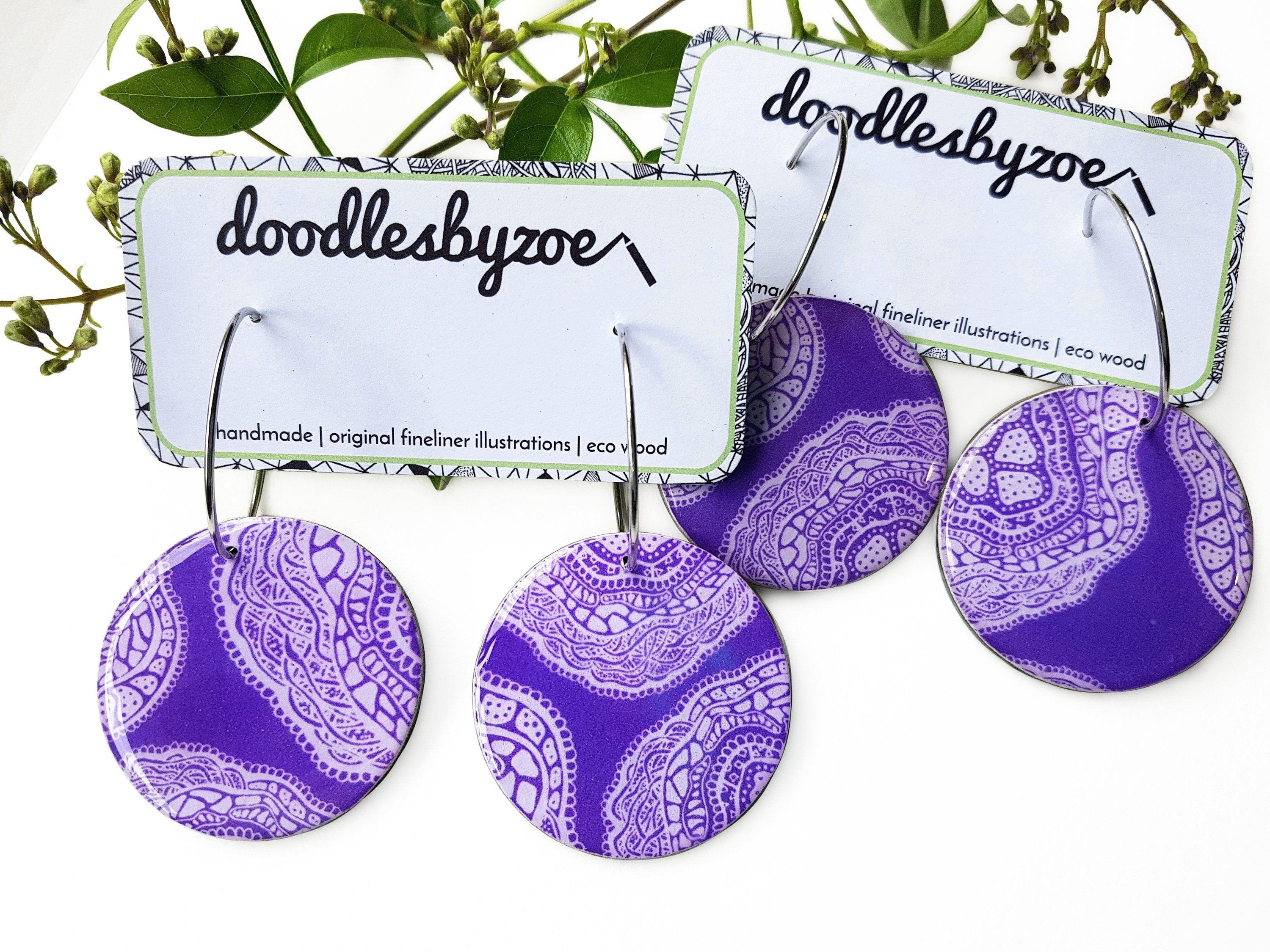 large disc earrings in the pattern purple haze