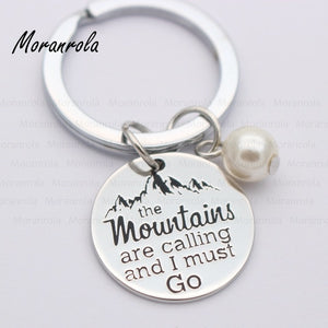 """The Mountains Are Calling And I Must Go"" Keychain"