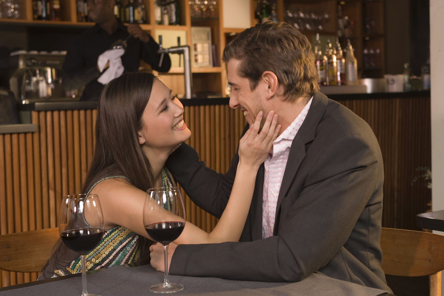 man and woman on a date in a wine bar
