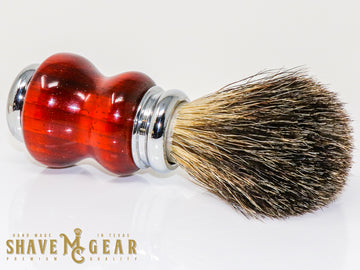 hand made badger brush in padauk wood on side