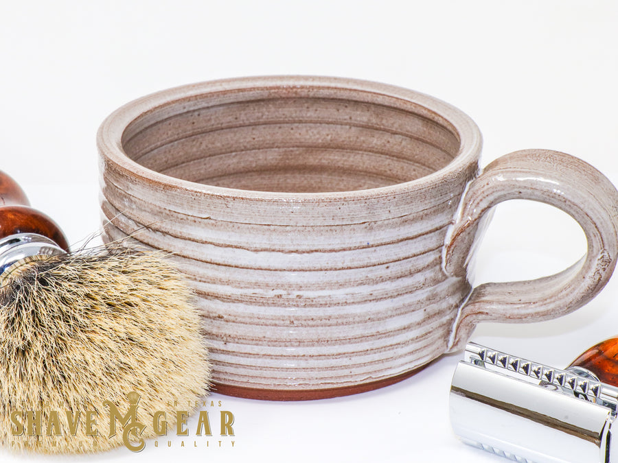 white hand made ceramic shave mug with badger hair shave brush and safety razor