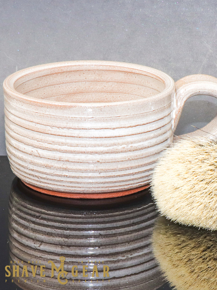 white hand made ceramic shave mug and silver tip badger shave brush