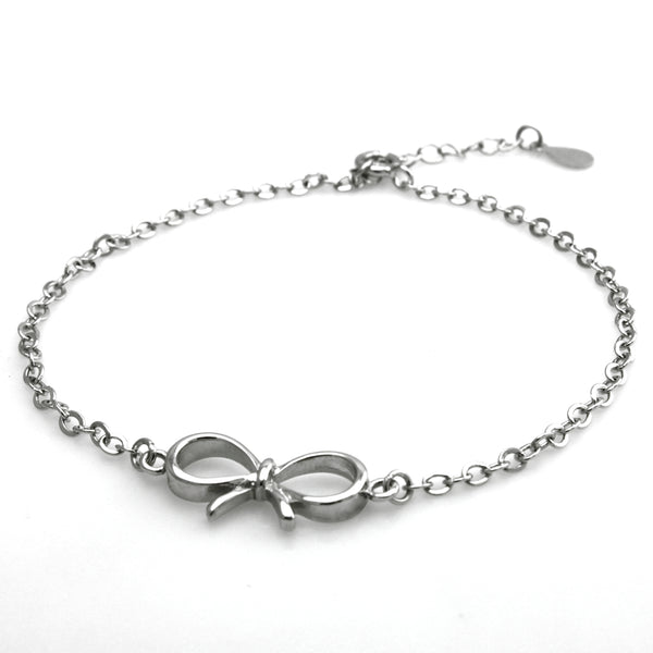 Sterling Silver Infinity Bow Ribbon Charm Bracelet - Tioneer