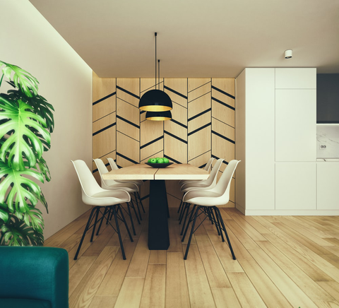 modern dining room featuring dynamic wall art