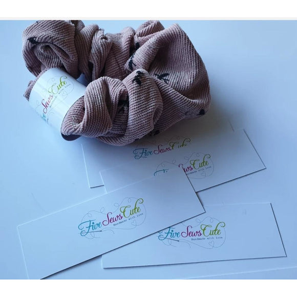 Scrunchie tag - belly band style wraps around the scrunchie with printed logo