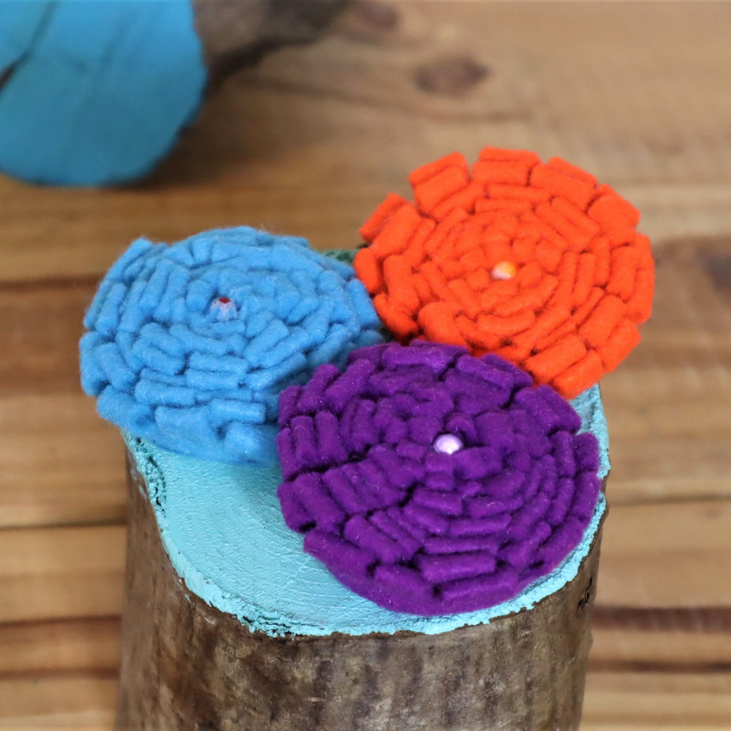 blue purple and orange flower brooches
