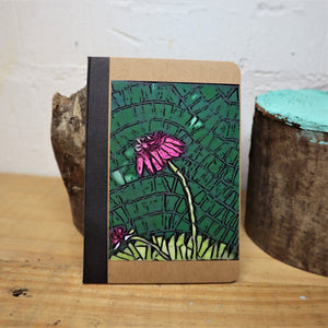 small notebook decorated with a photo of a flower mosaic