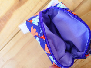 Purse in boxy shape, purple floral