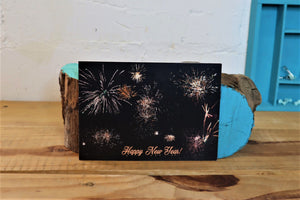 black card with fireworks and happy new year greeting