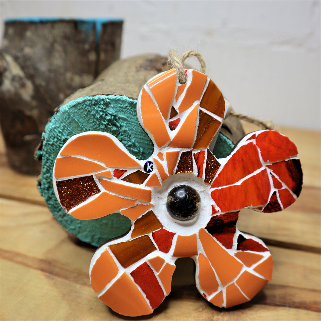 flower made from orange mosaic pieces