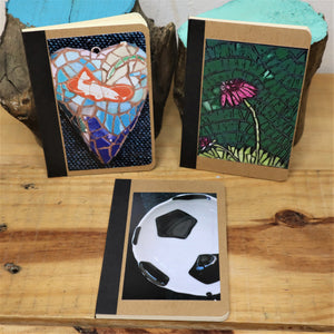 small notebooks decorated with photos of flower, heart and football mosaics