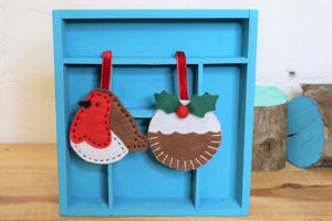 robin and christmas pudding christmas decorations hand sewn from felt