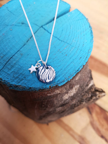 Blue and silver charm necklace