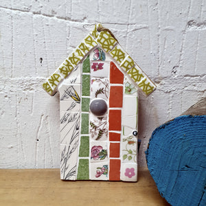 Coral floral beach hut styled mosaic decoration