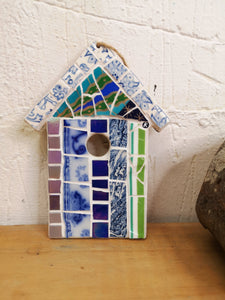 Wavy lines hanging beach hut styled mosaic decoration, green and blue design