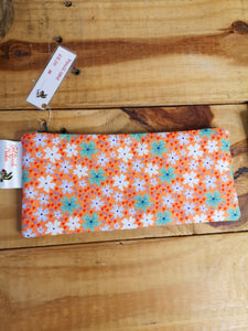 Floral pencil case, orange with green and white flowers