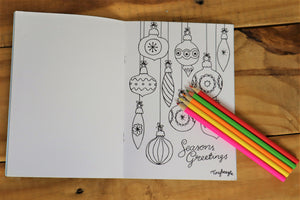 bauble christmas coloring page with coloured pencils.