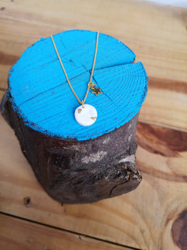 White and gold charm necklace