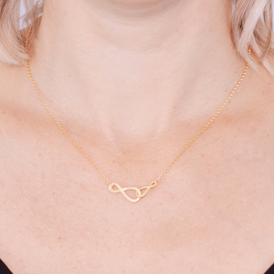 Gold Amelia necklace infinity symbol