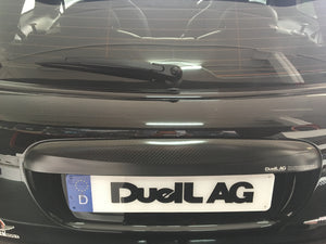 DuelL AG Carbon Fibre Trunk handle cover.