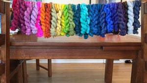a rainbow set of superwash merino minis from three fates yarns
