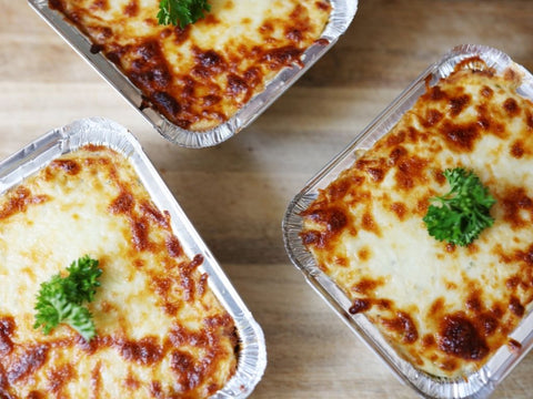 three containers of lasagna