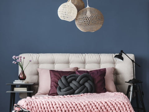 different textured and pattern pillows on a bed