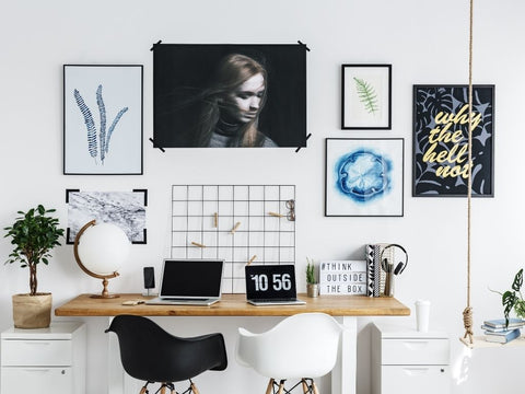 Photographs and paintings on top of a desk