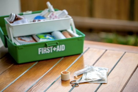 green first aid kit with the basics