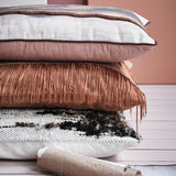 stack of textured throw pillows from HKliving USA