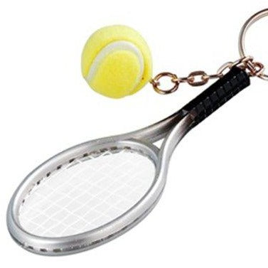 key chain of tennis racket and tennis ball