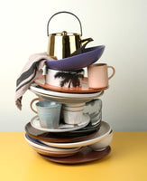 stack of HK living USA ceramics in pastel colors