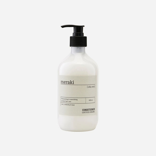 hair conditioner in a glass bottle with black pump