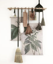 stillife of hk living wall charge and vintage looking dust brushes