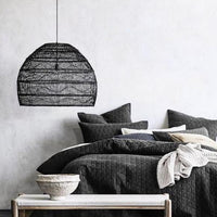 Bedroom with large black handwoven basket pendant light