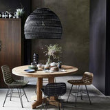 Dining room with black handwoven basket pendant light