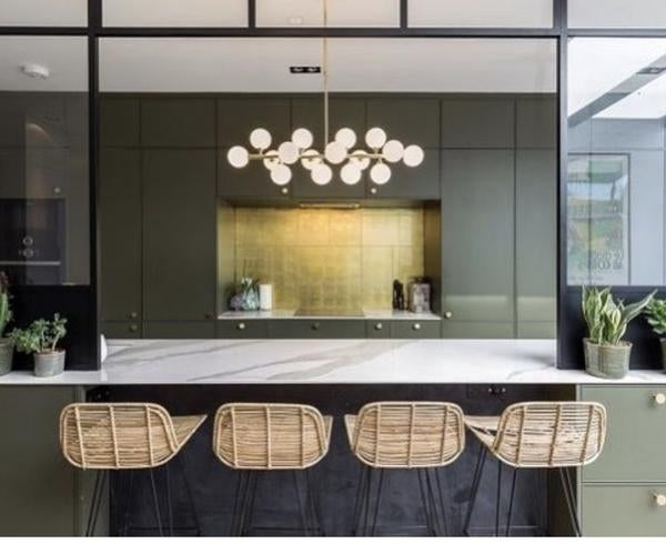 Kitchen with 4 natural rattan counter stools at the kitchen island