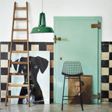 Green farm house door with old paintings and black metal wire bar stool by HK living