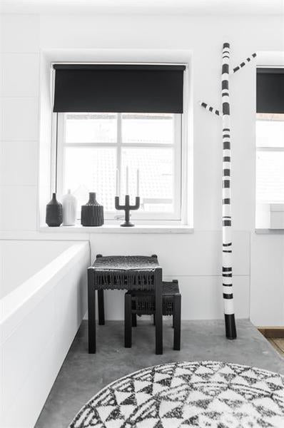Black and white styled bathroom with round bath at in large size