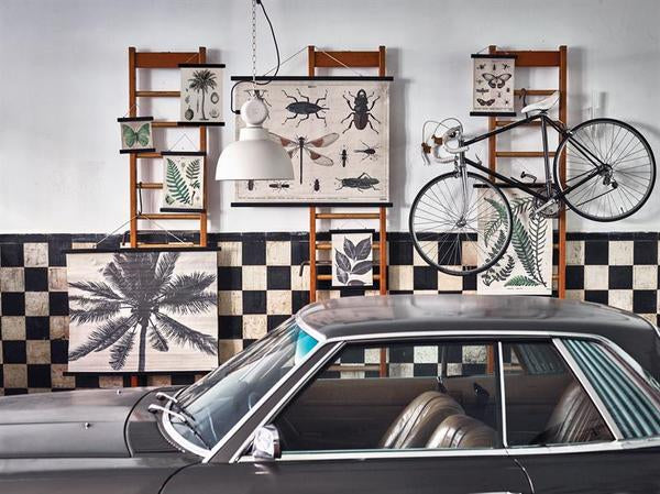 Garage with multiple cotton wall charts posters to add style