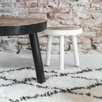 Organic tree table made of mango wood with black legs and bottom