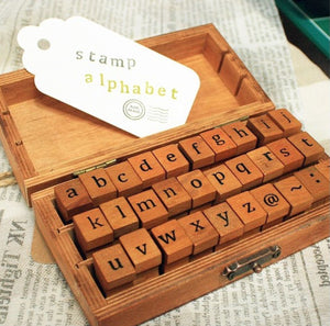 Wooden box with alphabet stamps