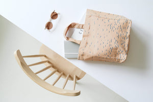 cotton bag on table with wooden chair