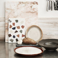 marble backsplash with colored terrazzo plate