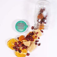 DIY cocktail in a jar with ingredients for apricot cranberry smash