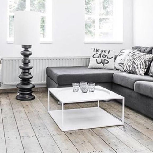 square white steel coffee table with grey couch