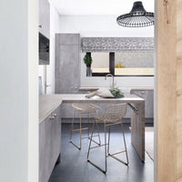 open kitchen with two metal brass wire counter stools under an kitchen island
