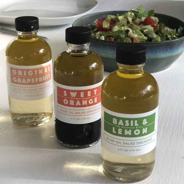 Set of 3 salad dressings in glass jars on a table with hkliving USA ceramics